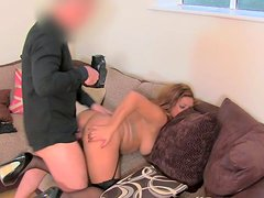 Blonde with full lips is sucking agent's dick