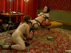 Delightful sirens Bella Rossi and Cherry Torn are in BDSM session