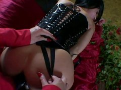 Torn slut in latex corset is drilled bad doggy style with big black strapon