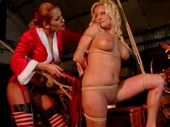 Buxom blonde whore with huge tits gets ready for BDSM session