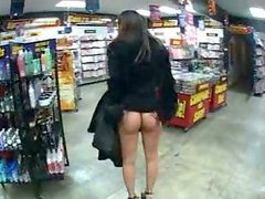 Lustful brunette whore buys a new dildo in sex shop