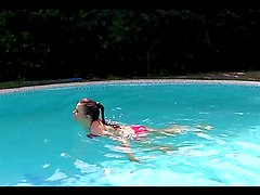 Brunette bimbo with huge natural tits gets banged by the pool