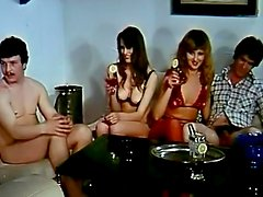 Redhead and brunette share a double dildo in this foursome