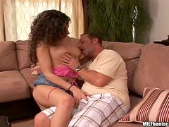 Curly milf pulls her mini skirt up and jumps on a hard cock