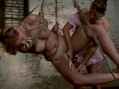 Ample blond MILF gets her body pinned with clothing pegs in BDSM sex scene