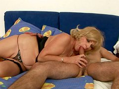 Buxom granny gives an amazing blowjob to young stud
