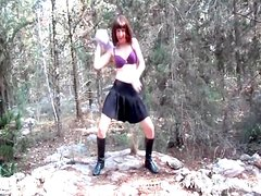 Amateur in skirt dances for her man outdoors