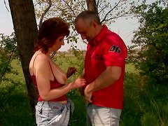 Dirty mature woman is sucking dick in the forest outdoor