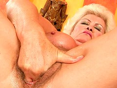 Skanky blond BBW hops on a vase with her hairy vagina