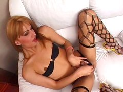 Gabriela and shemale girl Beta are masturbating ona bed watching each other