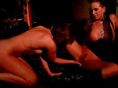 Horn made brunette domina gets her pussy fisted by submissive brunette
