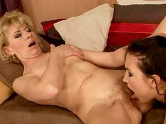 Young horny brunette eats the wet pussy of slutty blond old bitch