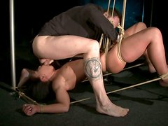 Vulnerable brunette with natural tits is tied up and teased with metal stuff