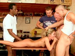 Wanton blond hussy gives head to group of voracious dudes in gangbang