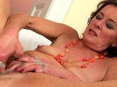 Horny granny with saggy boobs is solo masturbating with huge dildo