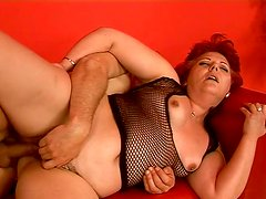 Fat red haired oldie rides a strong dick in reverse cowgirl position