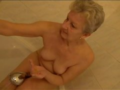 Shaved old pussy gets wet in the shower