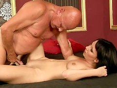 Young harlot gives an old fart one hell of a blowjob in 69 position