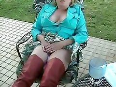 wife enjoying her toy in backyard - hubby films