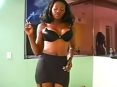 Watch a hottie in girdle and stockings smoke