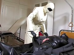 Strict rubber doctor Leila 1 of 4