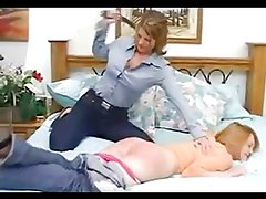Dominate lesbian spanking another girl
