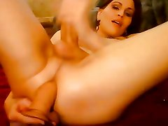 Tranny playing with hard cock and balls and dildo in ass