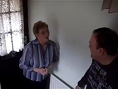 A Big-titted Slut Gives A Blowjob To A Dick In A Bedroom
