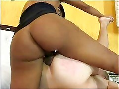 Busty chocolate tranny fucks a guy