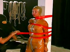 Rubber girl bound by ropes