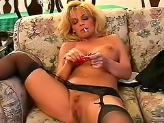 Milf smokes and has dildo sex