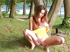 barefoot girl masturbationg in the park