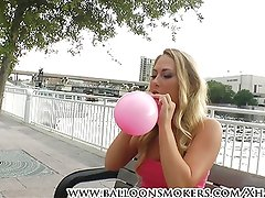 Teen blows to pop balloons outside in public
