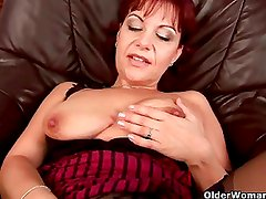 Soccer milf in stockings toying her wet pussy muscle