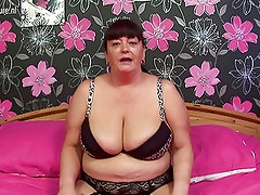 Big Granny with massive tits loves to get wet and wild