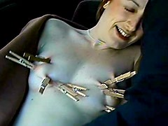 Kinky clothespin bondage in the car