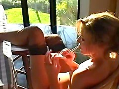 Carli Banks smokes and puts on stockings