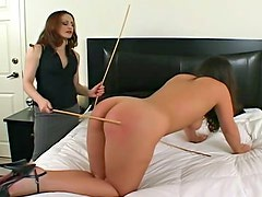 Long spanking video reddens her ass