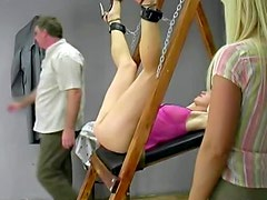 In pink lingerie the pretty girl is bound
