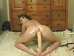 Hot Brunette with Big Dildo Ride