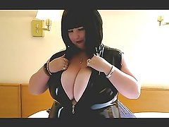 Busty PVC babe in my hotel bedroom