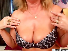 Buxom granny gives her old pussy a treat