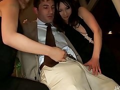 Two horny Japanese babes show a horny businessman the sights