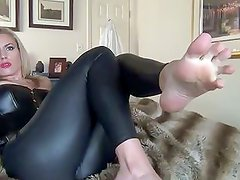 foot tease in leather leggings and high heels