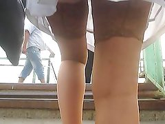 Girl in white skirt and stockings going upstairs 2