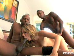 Booty and busty blondie is getting two huge black cocks at a time