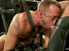 A gay gets mouth-fucked by his buddy in hot BDSM clip