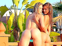 Guerlain and Madonna enjoy a sunny day at their pool. These two strip and