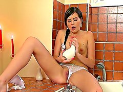 Horny Daniela Rose brings a sex toy with her into the bath, she pulls down