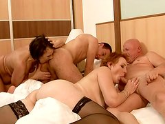 Mature sluts get their hot snatches fucked hard in group sex scene
